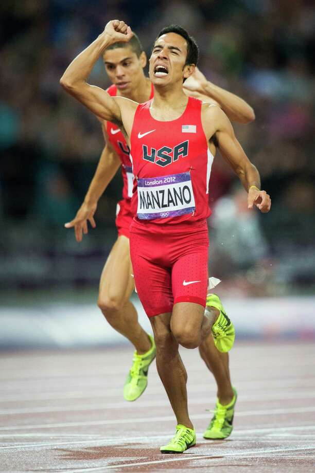 Leo Manzano of the USA celebrates as he crosses the finish line ahead of teammate Matt Centrowitz  to win the silver with a time of 3:34.79 in the men's 1,500-meters final during at the 2012 London Olympics on Tuesday, Aug. 7, 2012.  It was the first medal won by the USA in the event in 44 years.  The last medal was won by Jim Ryun took the silver at the Mexico City Games in 1968.  Manzano is a former Texas Longhorn from Marble Falls. Photo: Smiley N. Pool, Houston Chronicle / © 2012  Houston Chronicle