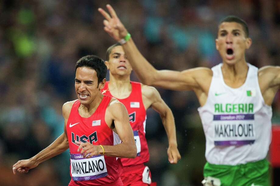 Leo Manzano of the USA crosses the finish line behind Taoufik Makhloufi of Algeria in the men's 1,500-meters final during at the 2012 London Olympics on Tuesday, Aug. 7, 2012. Manzano, a former Texas Longhorn from Marble Falls, took the silver medal in the event.  It was the first medal won by the USA in the event in 44 years.  The last medal was won by Jim Ryun took the silver at the Mexico City Games in 1968. Photo: Smiley N. Pool, Houston Chronicle / © 2012  Houston Chronicle