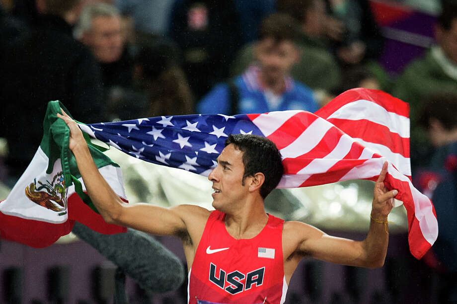 Leo Manzano of the USA carries the flags of the USA and Mexico as he takes a victory lap after winning the silver medal in the men's 1,500-meters final during at the 2012 London Olympics on Tuesday, Aug. 7, 2012.  It was the first medal won by the USA in the event in 44 years.  Manzano is a former Texas Longhorn from Marble Falls. Photo: Smiley N. Pool, Houston Chronicle / © 2012  Houston Chronicle