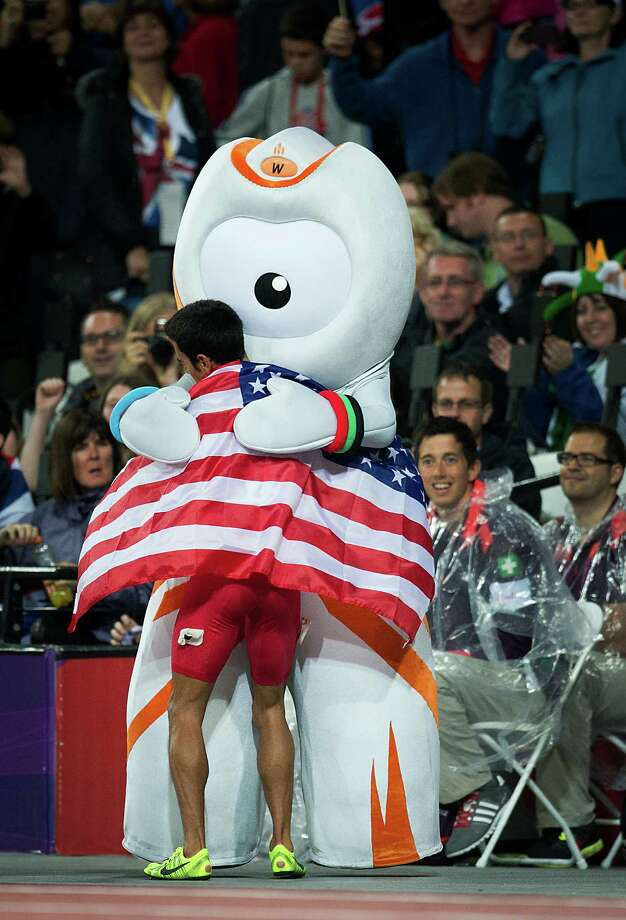 Leo Manzano of the USA gets a hug from London 2012 macot Wenlock after winning the silver medal in the men's 1,500-meters final during at the 2012 London Olympics on Tuesday, Aug. 7, 2012. Photo: Smiley N. Pool, Houston Chronicle / © 2012  Houston Chronicle