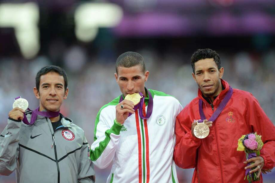 Algeria's gold medalist Taoufik Makhloufi (C), US silver medalist Leonel Manzano (L) and Morocco's bronze medalist Abdalaati Iguider (R) pose on the podium of the men's 1500m at the athletics event of the London 2012 Olympic Games on August 8, 2012 in London. Photo: JOHANNES EISELE, Getty Images / AFP