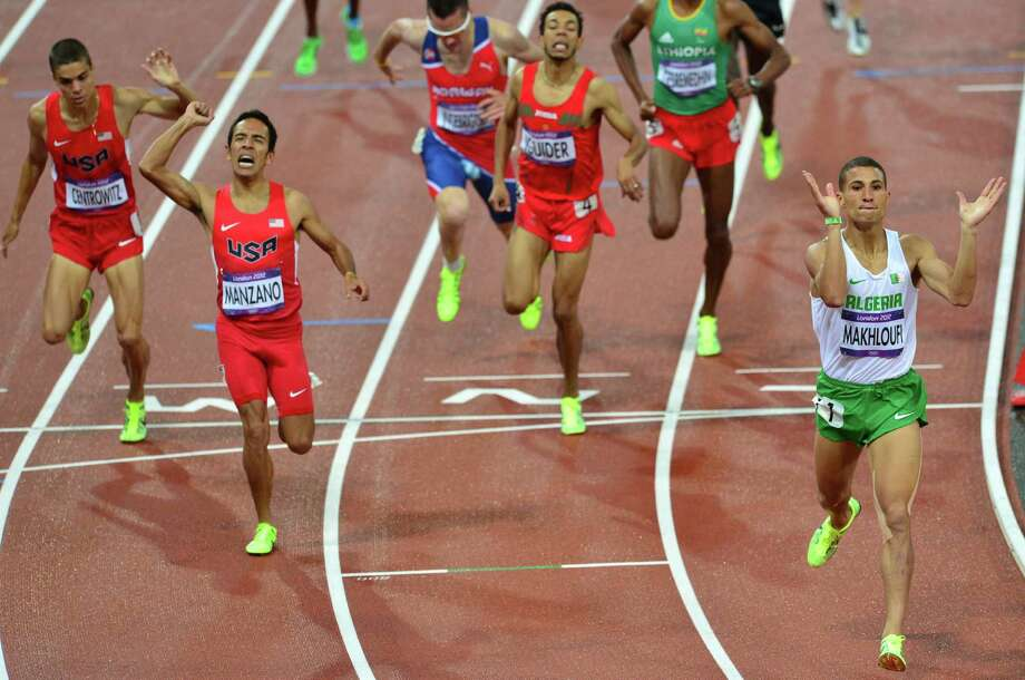 Algeria's Taoufik Makhloufi (R) celebrates after crossing the finish line of the men's 1500m final at the athletics event during the London 2012 Olympic Games on August 7, 2012 in London. (FromL US' Matthew Centrowitz, US' Leonel Manzano, and Morocco's Abdalaati Iguider). Photo: GABRIEL BOUYS, Getty Images / AFP