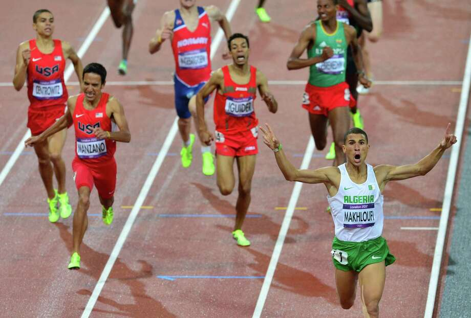 Algeria's Taoufik Makhloufi (R) celebrates as he crosses the finish line of the men's 1500m final at the athletics event during the London 2012 Olympic Games on August 7, 2012 in London. (FromL US' Matthew Centrowitz, US' Leonel Manzano, , Morocco's Abdalaati Iguider, and Ethiopia's Mekonnen Gebremedhin). Photo: GABRIEL BOUYS, Getty Images / AFP