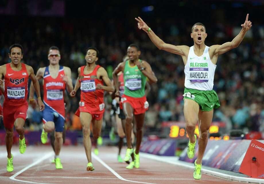 Algeria's Taoufik Makhloufi (R) celebrates as he crosses the finish line of the men's 1500m final at the athletics event during the London 2012 Olympic Games on August 7, 2012 in London. From left, USA's Leonel Manzano, Norway's Henrik Ingebrigtsen, Morocco's Abdalaati Iguider, and Ethiopia's Mekonnen Gebremedhin. Photo: OLIVIER MORIN, Getty Images / AFP