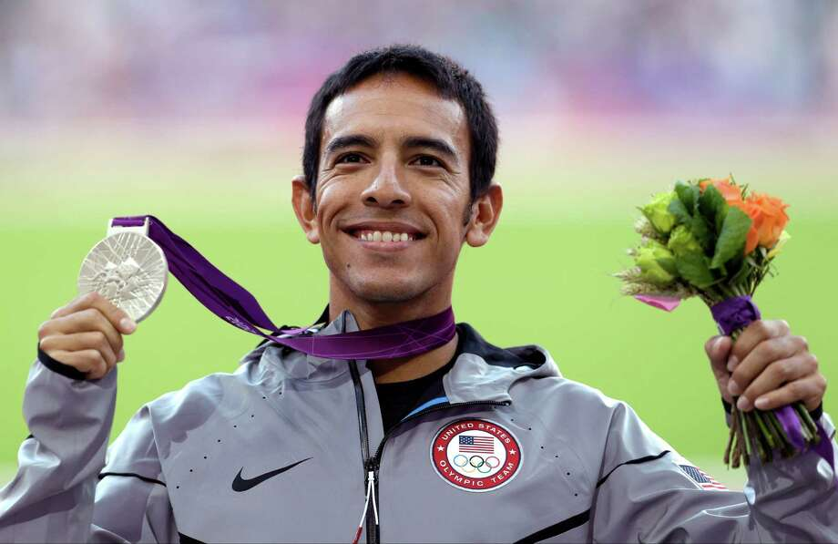 United States' Leonel Manzano poses with his silver medal in the men's 1500-meter final during the athletics in the Olympic Stadium at the 2012 Summer Olympics, London, Wednesday, Aug. 8, 2012.(AP Photo/Ben Curtis) Photo: Ben Curtis, Associated Press / AP