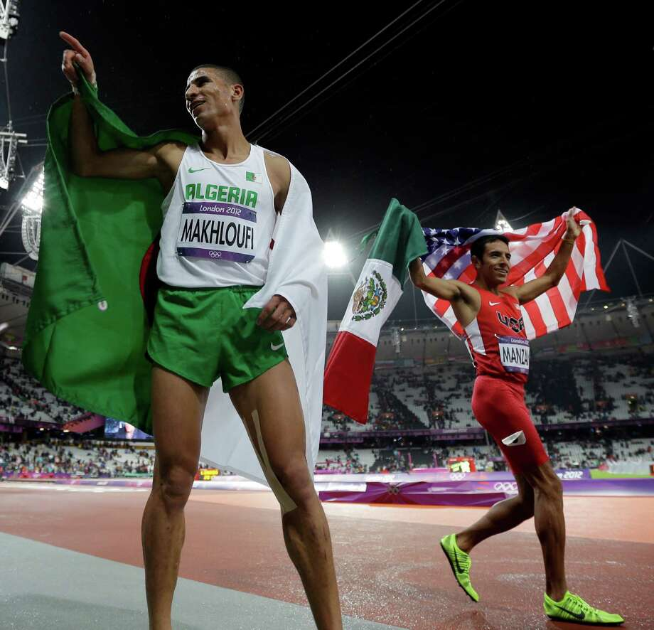 Gold medalist Taoufik Makhloufi of Algeria celebrates with silver medalist USA's Leonel Manzano after the men's 1500-meter during the athletics in the Olympic Stadium at the 2012 Summer Olympics, London, Tuesday, Aug. 7, 2012. (AP Photo/Matt Slocum) Photo: Matt Slocum, Associated Press / AP