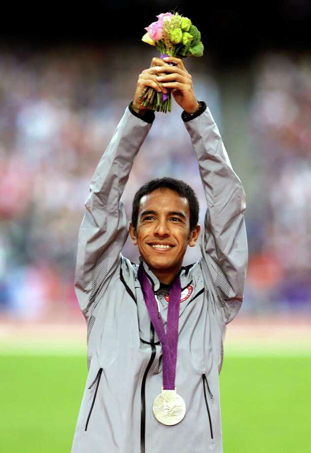 United States' Leonel Manzano gestures from the podium after being presented with the silver medal in the men's 1500-meter final during the athletics in the Olympic Stadium at the 2012 Summer Olympics, London, Wednesday, Aug. 8, 2012. (AP Photo/Ben Curtis) Photo: Ben Curtis, Associated Press / AP