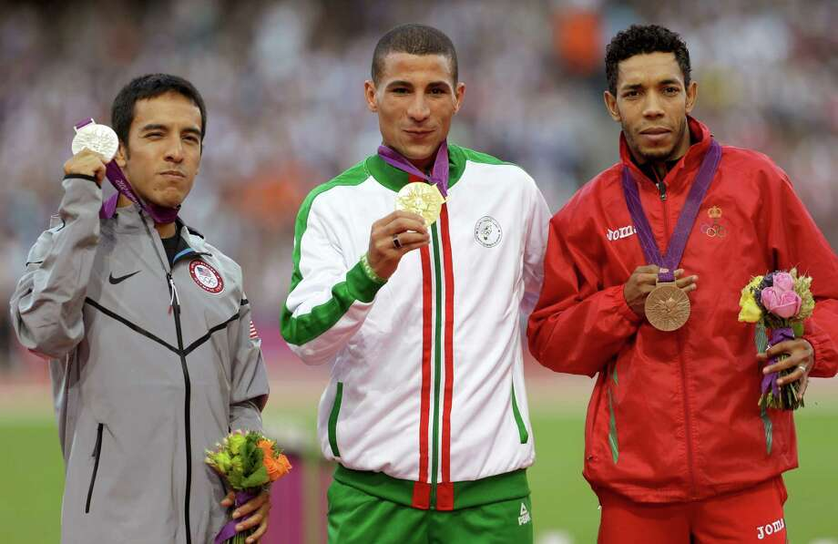 Men's 1500-meter medalists from left,  United States' Leonel Manzano, silver, Algeria's Taoufik Makhloufi gold, and Morocco's Abdalaati Iguider, bronze, pose for photographers during the athletics in the Olympic Stadium at the 2012 Summer Olympics, London, Wednesday, Aug. 8, 2012. (AP Photo/Ben Curtis) Photo: Ben Curtis, Associated Press / AP