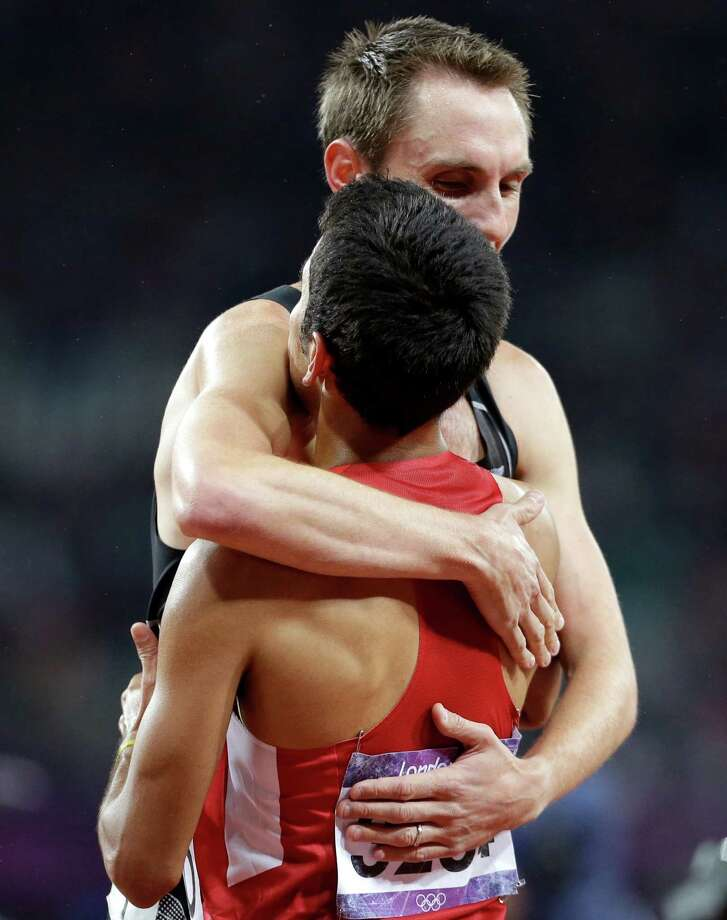 New Zealand's Nicholas Willis embraces United States' Leonel Manzano after his silver medal win in the silver in the men's 1500-meter final during the athletics in the Olympic Stadium at the 2012 Summer Olympics, London, Tuesday, Aug. 7, 2012. (AP Photo/Anja Niedringhaus) Photo: Anja Niedringhaus, Associated Press / AP