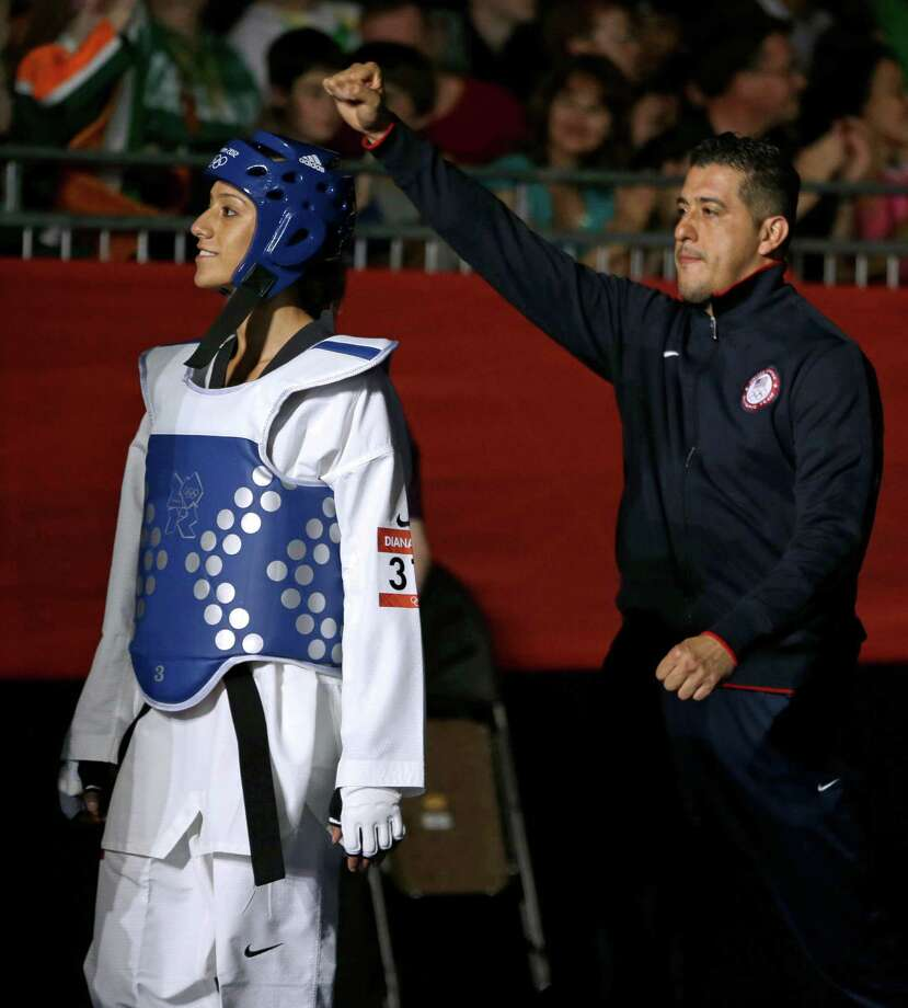 United States' Diana Lopez makes her way to fight China's Hou Yuzhuo in women's 57-kg taekwondo competition at the 2012 Summer Olympics, Thursday, Aug. 9, 2012, in London. Photo: Ng Han Guan