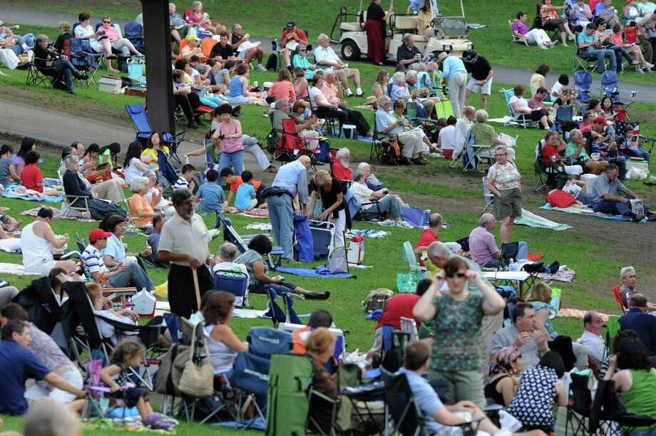 Audience members find seats on the lawn before a performance by the Philadelphia Orchestra at Saratoga Performing Arts Center Wednesday, Aug. 8, 2012 in Saratoga Springs, N.Y. (Lori Van Buren / Times Union) Photo: Lori Van Buren