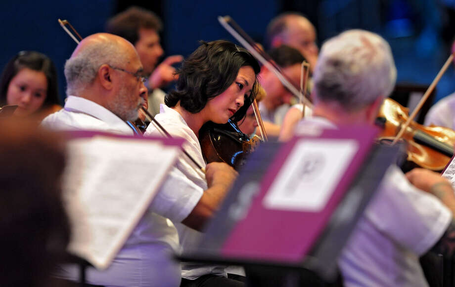 Members of the Philadelphia Orchestra warm up before a performance at Saratoga Performing Arts Center Wednesday, Aug. 8, 2012 in Saratoga Springs, N.Y. (Lori Van Buren / Times Union) Photo: Lori Van Buren