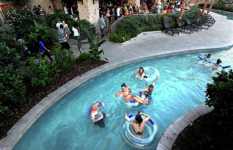 Partiers float down the lazy river during the Liquid Society party a L'Auberge in Lake Charles, Thursday, July 26, 2012. Tammy McKinley/The Enterprise Photo: TAMMY MCKINLEY