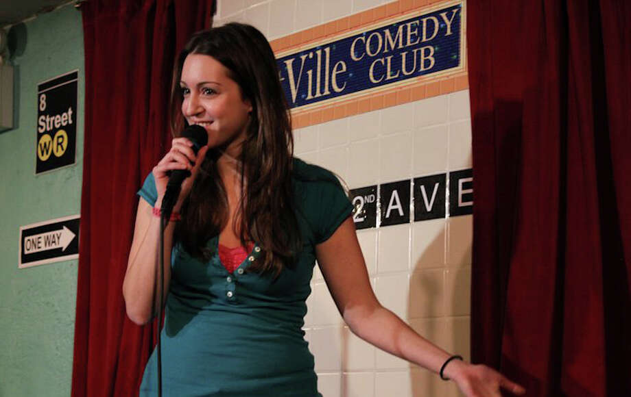 Karen Summerton performs stand up in New York City. The Darien native is taking her acting career to new heights with parts in a national commercial and an upcoming MTV show. Photo courtesy of Young Jeohn Photo: Contributed Photo