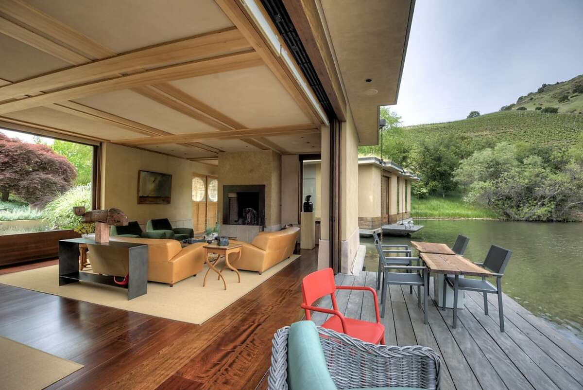 The rooms all open to the lake to provide splendid views. The three cantilevered terraces appear to float above the lake.