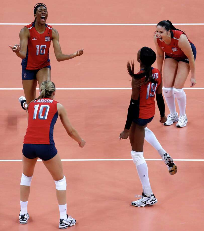 Members of team United States, clockwise from top left, Foluke Akinradewo, Lindsey Berg, Destinee Hooker and Jordan Larson celebrate after defeating South Korea in a women's semifinal volleyball match at the 2012 Summer Olympics, Thursday, Aug. 9, 2012, in London. (AP Photo/Jeff Roberson) Photo: Jeff Roberson, Associated Press / AP