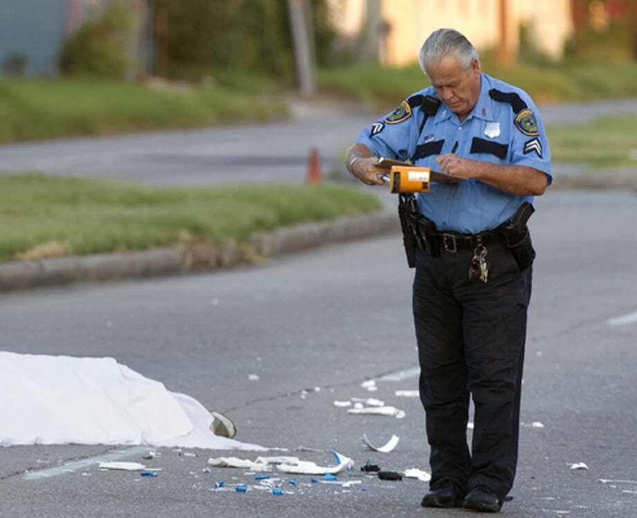 Authorities investigate the scene of a hit-and-run in front of Doctors Hospital-Tidwell Thursday, Aug. 9, 2012, in Houston. Authorities said the man was struck by two vehicles when he tried to cross the street after leaving the hospital. Both vehicles fled the scene. Photo: .