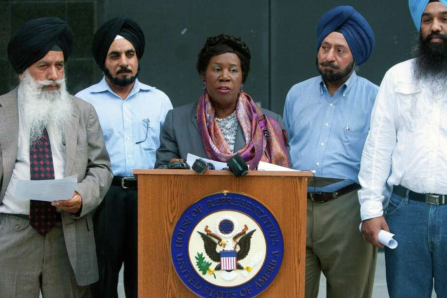 From left to right, Hardial Singh Mangat, left, Daljit Singh, Tara Singh and Sukhdeep Singh, watch as Congresswoman Sheila Jackson Lee, center, speaks during a news conference in front of the Federal Courthouse Thursday, Aug. 9, 2012, in Houston.  Members of the Sikh community came together with Congresswoman Sheila Jackson Lee to discuss her letter to Attorney General Holder which asked for among other things a Federal Task Force to study recent and past attacks on the Sikh community and how these attacks can be stopped. Photo: Cody Duty, Houston Chronicle / © 2011 Houston Chronicle