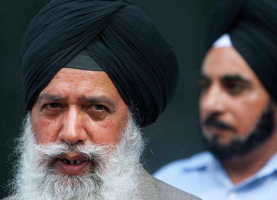 Daljit Singh, right, watches as Hardial Singh Mangat, left, speaks during a news conference in front of the Federal Courthouse Thursday, Aug. 9, 2012, in Houston. Members of the Sikh community came together with Congresswoman Sheila Jackson Lee to discuss her letter to Attorney General Holder which asked for among other things a Federal Task Force to study recent and past attacks on the Sikh community and how these attacks can be stopped. (Cody Duty / Houston Chronicle) Photo: Cody Duty / © 2011 Houston Chronicle