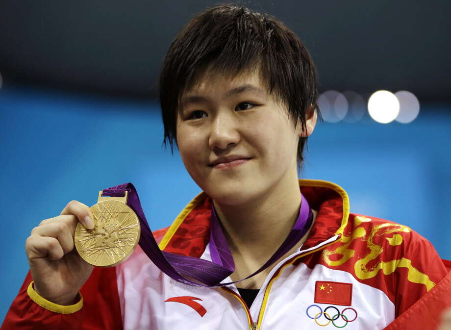"In this July 31, 2012 file photo, China's Ye Shiwen, 16, poses with her gold medal for the women's 200-meter individual medley swimming final at the Aquatics Centre in the Olympic Park during the 2012 Summer Olympics in London. The Chinese media reacted angrily to doping accusations against their newest swimming superstar Ye who won two gold medals at the London Olympics. Scrutiny of the Chinese swimming star intensified after Ye swam the last lap of the 400 medley a split second faster than U.S. men's gold medalist Ryan Lochte. U.S. coach John Leonard was quoted by the British media calling Ye's performances ""unbelievable"" and ""disturbing."" Despite the allegations, no evidence has emerged to support doping claims and the Olympic Association has maintained the Chinese swimmer is ""clean."" Photo:"