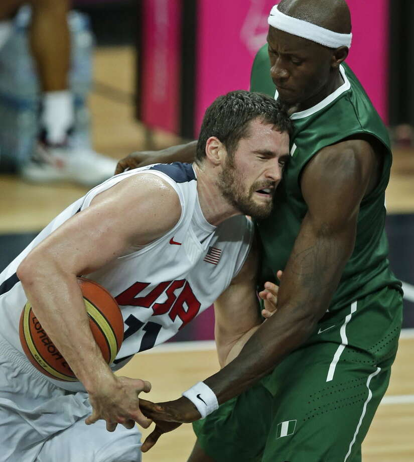The U.S. men's basketball team smashed the Olympic record for most points in a game beating Nigeria 156-73 on Aug. 2. But detractors called the game a rout and criticized the team for its unsportsmanlike conduct. Nigeria's Richard Oruche, right, tries to steal the ball from United States' Kevin Love during a men's basketball game at the 2012 Summer Olympics, Thursday, Aug. 2, 2012, in London. (AP Photo/Charlie Riedel). Photo: