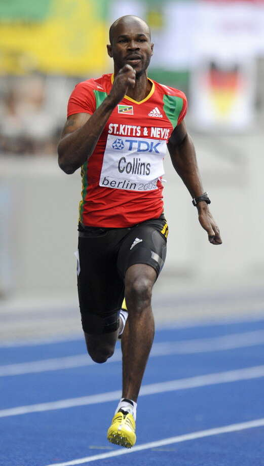 Former 100 meters world champion Kim Collins was axed from St Kitts and Nevis' Olympic squad on Aug. 4 after he left the athletes' village to spend the night with his wife in a hotel. The 36-year-old -- who despite his age won 100 meters bronze at last year's world championships -- was disciplined for repeated absences from the squad's training camp, a statement said. The Associated Press reported that Collins returned to the Olympic Village on Saturday morning to find that his accreditation had been canceled, locking him out of the village. Collins had carried the St. Kitts and Nevis flag at the opening ceremony this year. This picture shows Saint Kiits and Nevis' Kim Collins competing in the men's 200m round 1 heat 7 race of the 2009 IAAF Athletics World Championships in Berlin. (Oliver Morin/AFP Getty Images/ August 18, 2009). Photo: