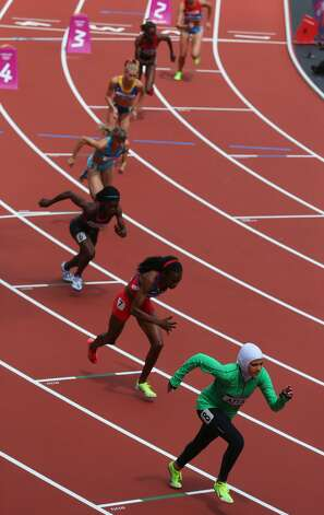 Sarah Attar of Saudi Arabia competes in the Women's 800m Round 1 Heats on Day 12 of the London 2012 Olympic Games at Olympic Stadium on August 8, 2012 in London, England. (Alexander Hassenstein / Getty Images)
