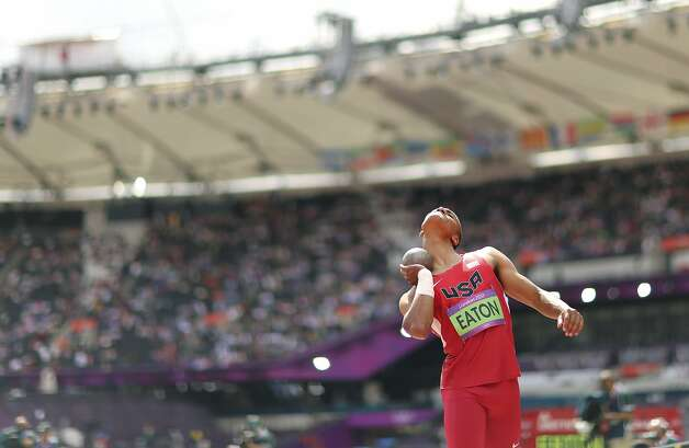 Ashton Eaton of the U.S. competes during the shot put portion of the men's track and field decathlon at the 2012 Summer Olympic Games in London, Aug. 8, 2012. (JED JACOBSOHN / New York Times)