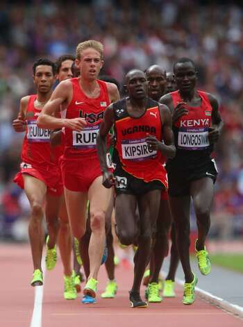 Galen Rupp of the United States, Moses Ndiema Kipsiro of Uganda and Thomas Pkemei Longosiwa of Kenya compete in the Men's 5000m Round 1 Heats on Day 12 of the London 2012 Olympic Games at Olympic Stadium on August 8, 2012 in London, England.  (Alexander Hassenstein / Getty Images)