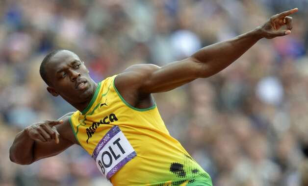 Jamaica's Usain Bolt gestures before the men's 200m heats at the athletics event during the London 2012 Olympic Games on August 7, 2012 in London.   (ERIC FEFERBERG / AFP/Getty Images)