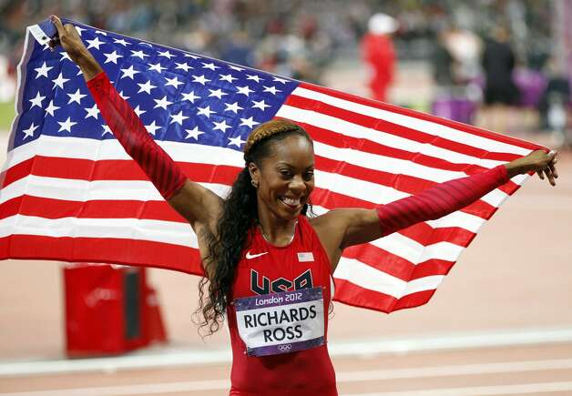 USA's Sanya Richards-Ross smiles after finding out she won the women's 400 meter final during the Summer Olympic Games on Sunday, August 5, 2012 in London, England. Richards-Ross finished with a time of 49.55 seconds to take gold.  (Vernon Bryant / McClatchy-Tribune News Service)
