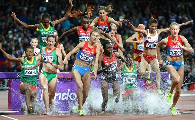 Russia's Yuliya Zaripova, far right, leads the pack in the 3,000-meter steeplechase during the Summer Olympic Games in London, England on Monday, August 6, 2012. Zaripova  won gold.  (Wally Skalij / McClatchy-Tribune News Service)