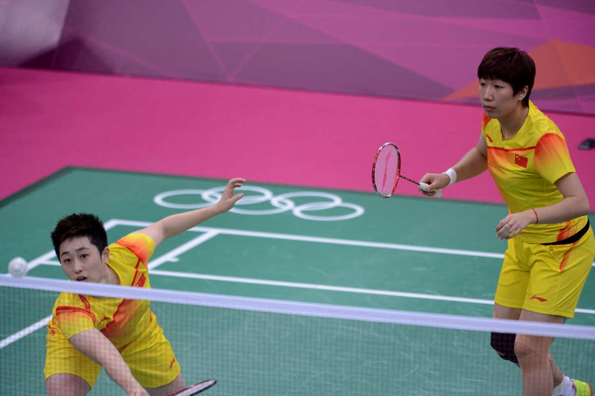 Yu Yang (L), and her teammate Wang Xiaoli, play in the women's double badminton match against Kim Ha-Na and Jung Kyung-Eun of South Korea on July 31, at the London 2012 Olympic Games. Yu, her teammate and six other female badminton players, (four from South Korea and two from Indonesia), were eventually disqualified from the Olympics for throwing matches during the doubles competition to create a favorable draw. Yu has since announced on her blog that she is quitting the sport, saying her dreams have been