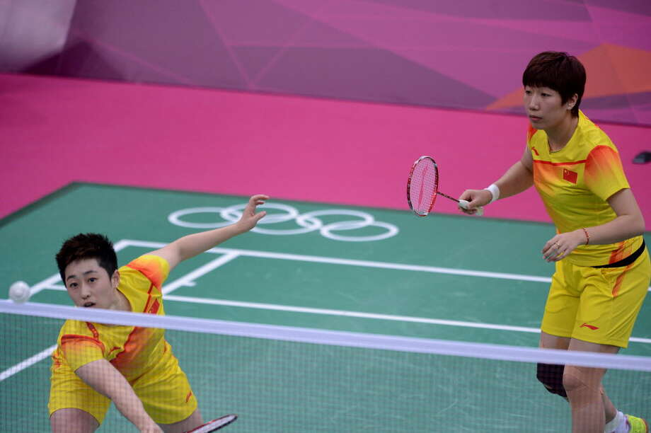 "Yu Yang (L), and her teammate Wang Xiaoli, play in the women's double badminton match against Kim Ha-Na and Jung Kyung-Eun of South Korea on July 31, at the London 2012 Olympic Games. Yu, her teammate and six other female badminton players, (four from South Korea and two from Indonesia), were eventually disqualified from the Olympics for throwing matches during the doubles competition to create a favorable draw. Yu has since announced on her blog that she is quitting the sport, saying her dreams have been ""heartlessly shattered."" (Adek Berry/AFP/Getty Images). Photo:"