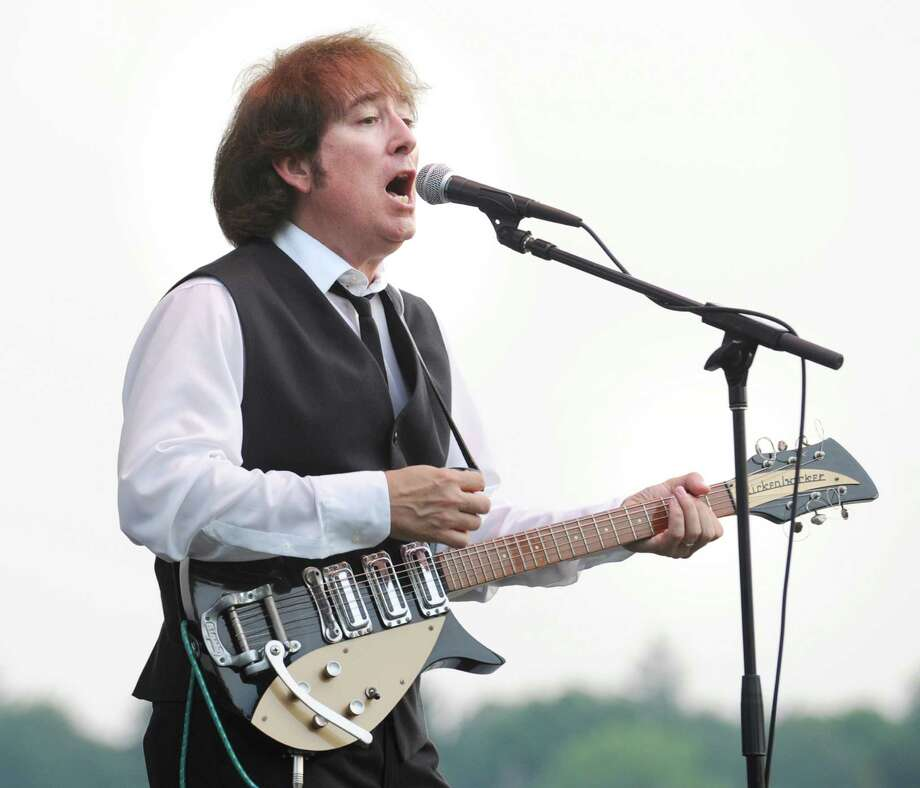 Pete Gendron plays his Rickenbacker electric guitar while fronting The Octopuses Garden, a Beatles tribute band, during a performance at Roger Sherman Baldwin Park in Greenwich, Wednesday night, Aug. 8, 2012. Photo: Bob Luckey / Greenwich Time
