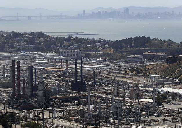 The No. 4 Crude Unit (lower left) is seen at the Chevron Refinery in Richmond, Calif. on Tuesday, Aug. 7, 2012, one day after an explosion and fire rocked the area and sent a giant plume of black smoke into the atmosphere. Photo: Paul Chinn, The Chronicle