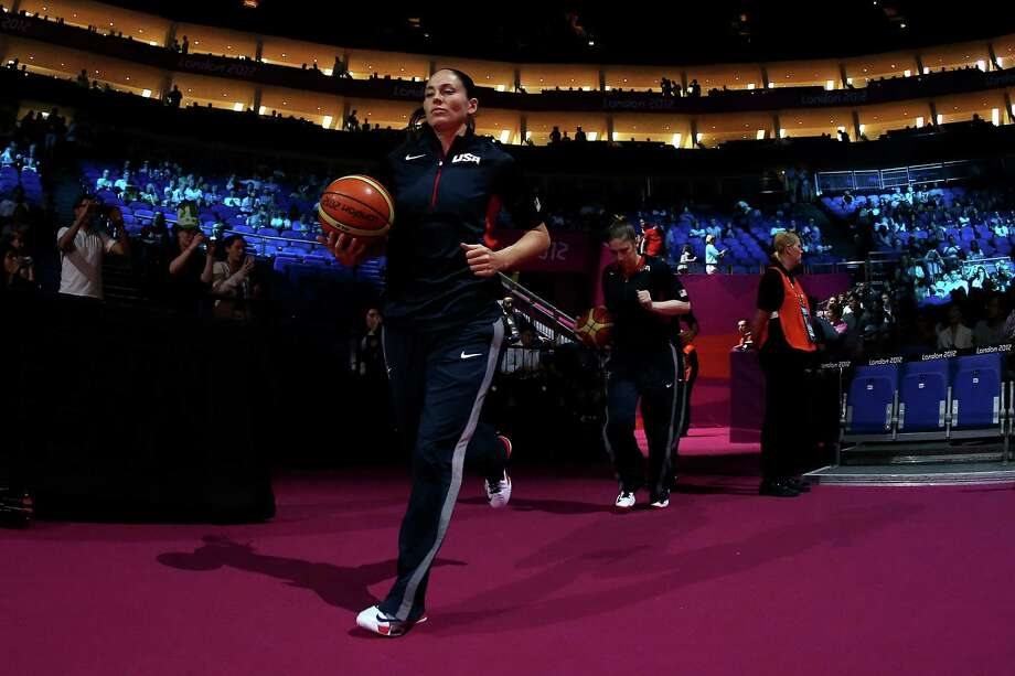 LONDON, ENGLAND - AUGUST 09:  Sue Bird of United States lead teammates out onto the floor before the Women's Basketball semifinal against Australia on Day 13 of the London 2012 Olympics Games at North Greenwich Arena on August 9, 2012 in London, England. Photo: Christian Petersen, Getty Images / 2012 Getty Images