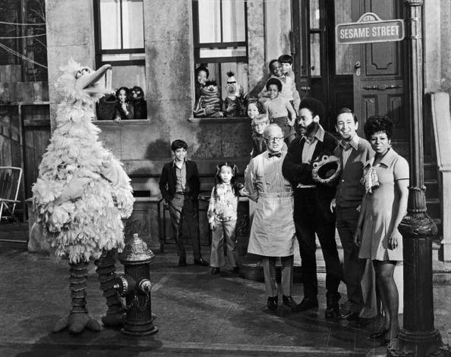 "The other half of the Henson legacy, of course, is ""Sesame Street,"" which started in 1969. Here's are original cast members posing on the set with some of the puppet characters."