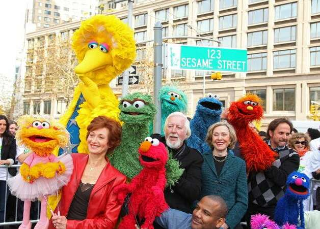 "File: Sesame Street founder and TV producer Joan Ganz Cooney (C) and Sesame Street cast members pose under a '123 Sesame Street' sign the ""Sesame Street"" 40th Anniversary temporary street renaming in Dante Park on November 9, 2009 in New York City.  (Photo by Mike Coppola/FilmMagic) (FilmMagic)"