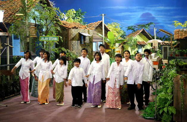 "Children perform at ""Jalan Sesama,"" the Indonesian version of Sesame Street, during a ceremony in Jakarta, 22 May 2007. A book-reading orangutan and a rhino sporting a mohawk was among the puppets aired on an Indonesian version of ""Sesame Street."" Jalan Sesama features stories, songs and music in the Bahasa language and is set in an Indonesian village rather than the New York neighborhood featured in the main American version of the educational program. (Photo BAY ISMOYO/AFP/Getty Images) (AFP/Getty Images)"