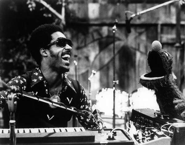 File: Stevie Wonder performing his song Superstitious on Sesame Street with S.S. character Grover. (Photo by Echoes/Redferns) (Redferns)