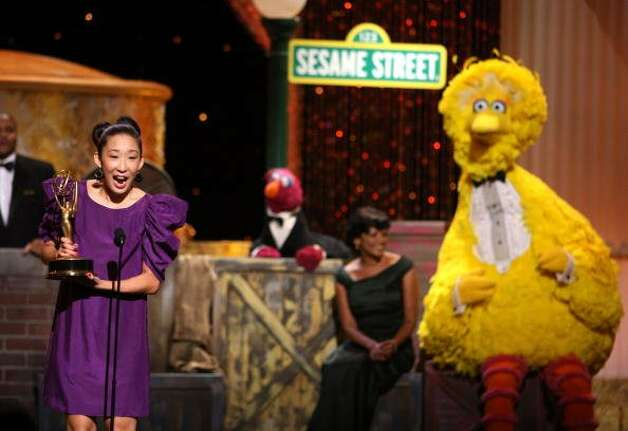 File: Actress Sandra Oh presents the cast of 'Sesame Street' with the Lifetime Achievement Award during the 36th Annual Daytime Emmy Awards at The Orpheum Theater on August 30, 2009 in Los Angeles, California.  (Photo by John Shearer/Getty Images for ATI)