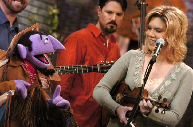 File: Alison Krauss and The Union Station join The Count puppet in a number counting jamboree. (Photo by Theo Wargo/WireImage for Sesame Workshop) (WireImage for Sesame Workshop)