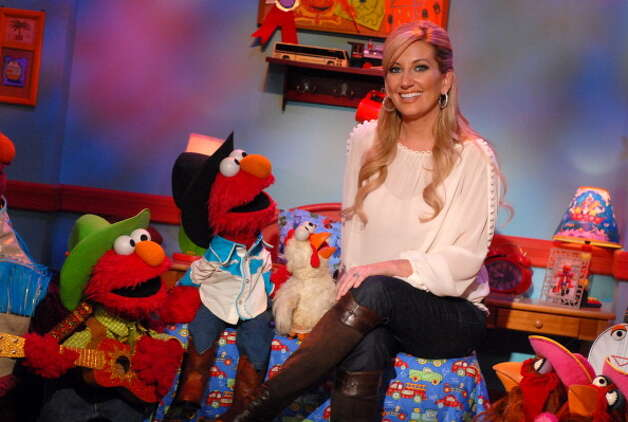 "File: Lee Ann Womack with Elmo and his country cousin Elmer - Country Sensation. Lee Ann Womack visited the set of Sesame Street to tape a music video for ""Kids' Favorite Country Songs."" (Photo by Theo Wargo/WireImage) (WireImage)"