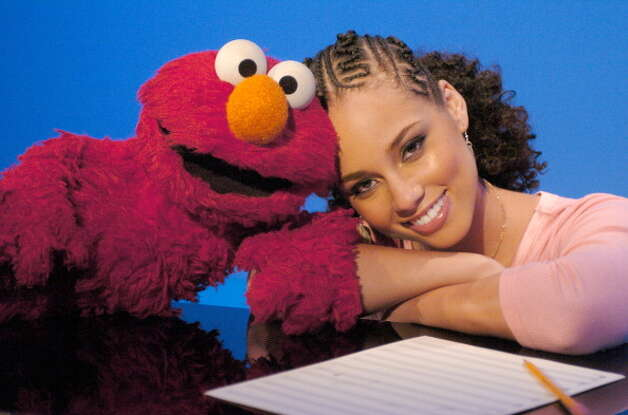"File: Alicia Keys joins her favorite dance partner Elmo on Sesame Street. The duo sang ""Dancing"" a rendition of her hit song ""Falling"". It was aired as part of Sesame Street's 36th season, April 14, 2005 (Photo by Theo Wargo/WireImage for Sesame Workshop) (WireImage for Sesame Workshop)"