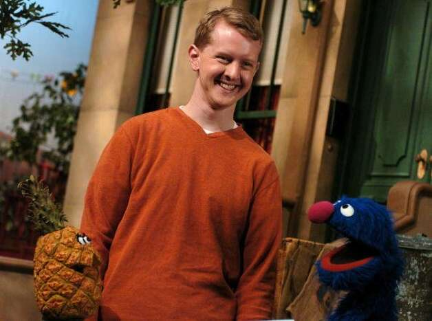 File: Sesame Street's Grover tests Jeopardy Champ Ken Jennings knowledge of healthy foods. (Photo by Theo Wargo/WireImage) (WireImage)