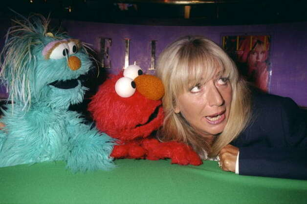 File: Penny Marshall gets together with Muppet's Rosita and Elmo at a Fashion Cafe fashion show. Marshall was helping K-Mart introduce its Sesame Street line of children's clothing.  (Photo by Richard Corkery/Getty Images) (NY Daily News via Getty Images)