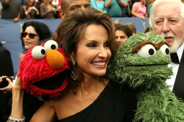 File: Actress Susan Lucci poses with Sesame Street characters Elmo (L) and Oscar the Grouch (R) arrives at the 33rd Annual Daytime Emmy Awards held at the Kodak Theater on April 28, 2006 in Hollywood, California.  (Photo by Frederick M. Brown/Getty Images) (Getty Images)