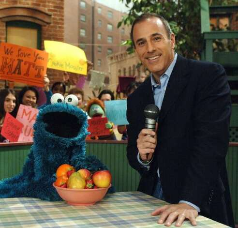 File: Matt Lauer visits Sesame Street for an exclusive interview with Cookie Monster, August 14th on PBS KIDS. (Photo Theo Wargo/WireImage for Sesame Workshop)