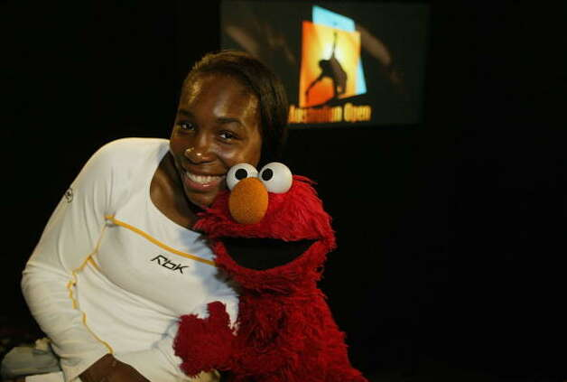 File: Venus Williams meets Elmo of Sesame Street during the Australian Open Tennis Championships at Melbourne Park, Melbourne, Australia on January 17, 2003. (Photo by Sean Garnsworthy/Getty Images). (Getty Images)